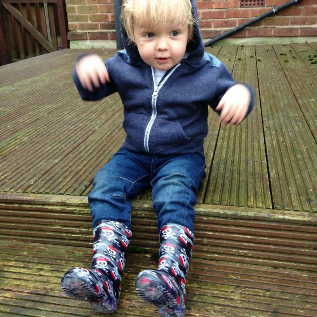Oscar loves his wellies