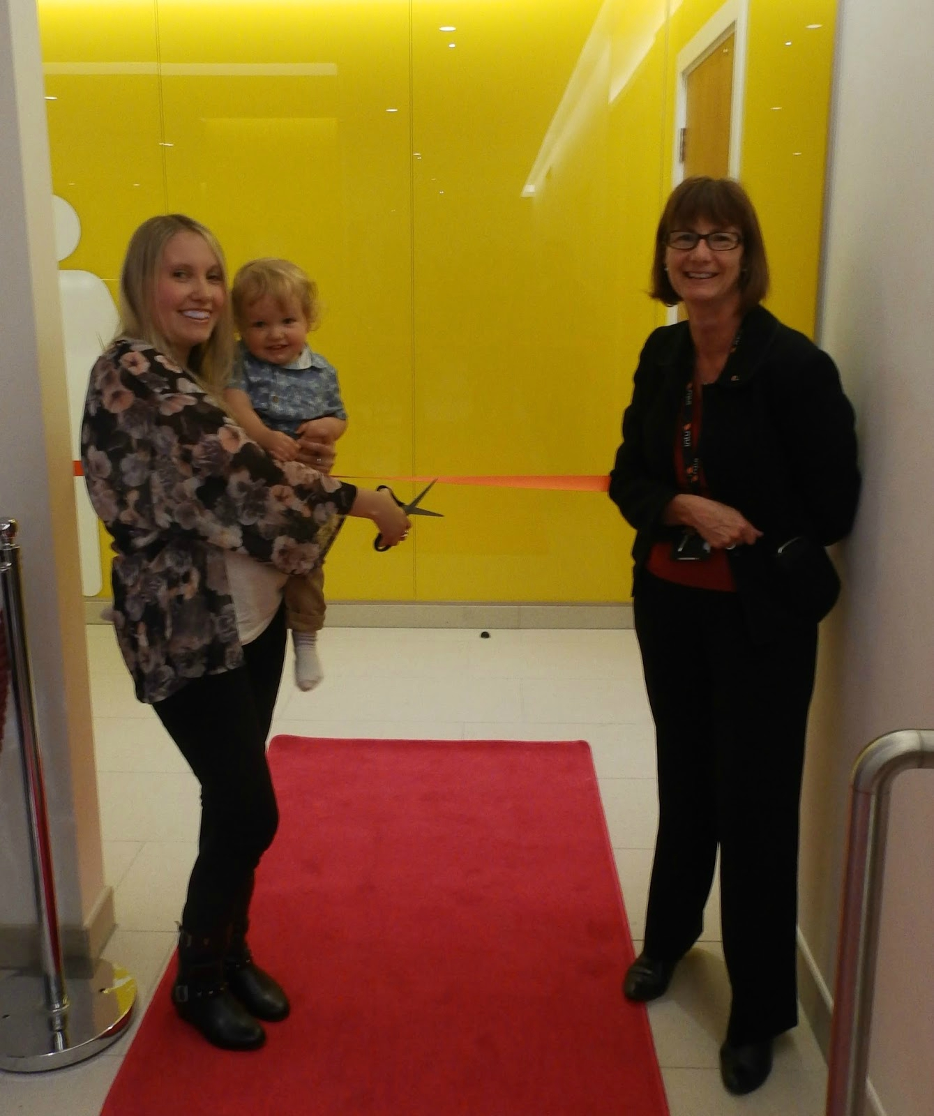 With love from Lou cutting the ribbon at the opening of the family friendly toilet block in the Intu Victoria Centre