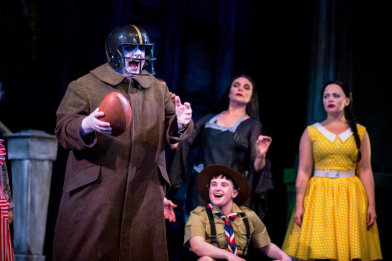 Uncle Fester and the Cast of The Addams Family