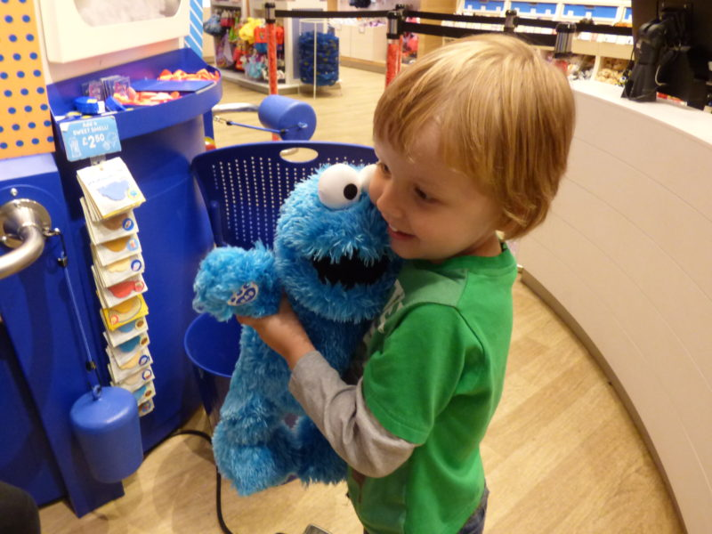 Oscar Cuddling The Cookie Monster