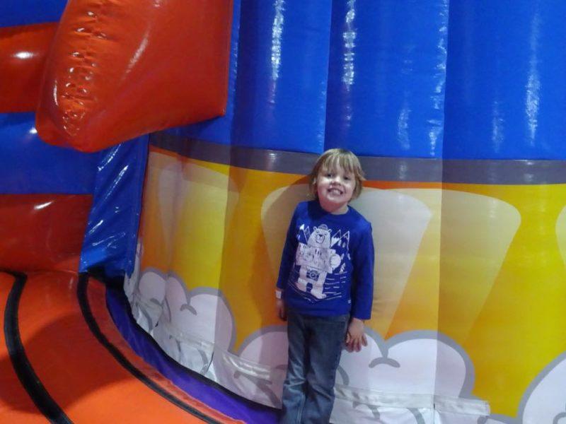 Oscar standing at the side of the Helter Skelter Rocket Slide at Planet Bounce Nottingham