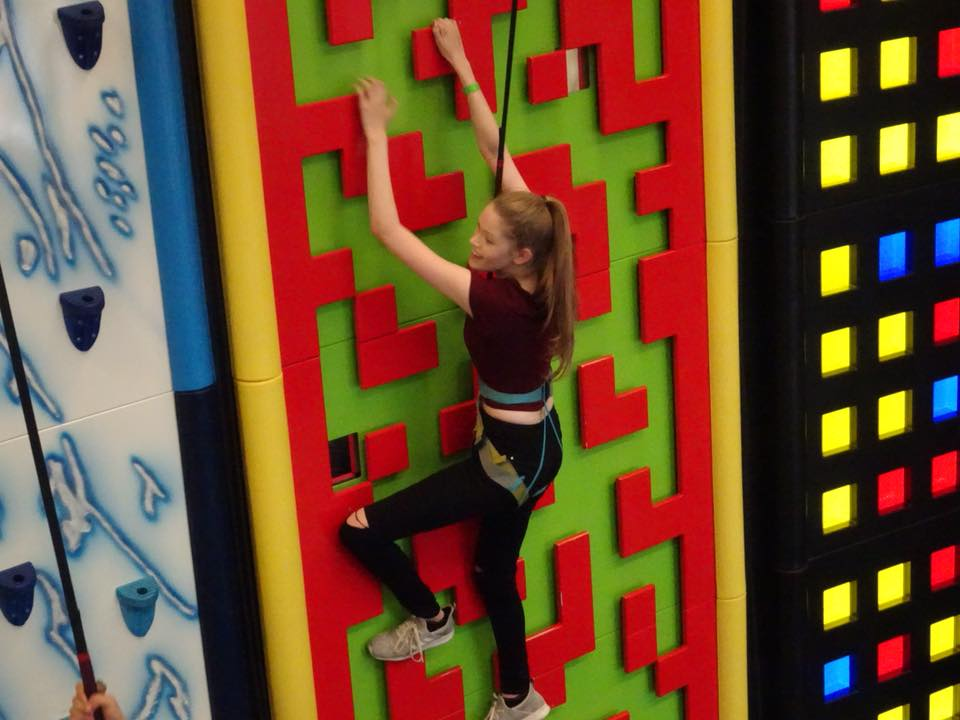 Stacey climbing a wall at Clip 'N Climb Nottingham