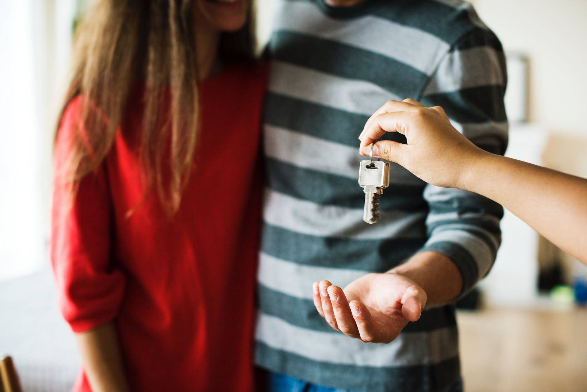 Couple getting keys to a new car