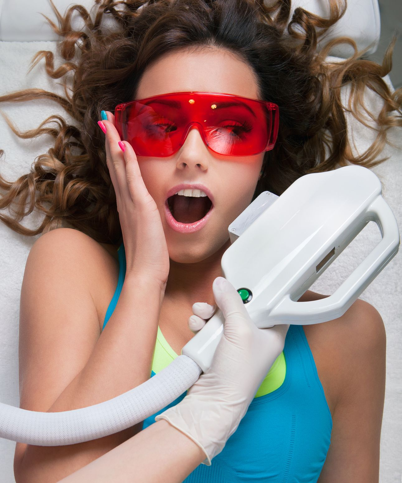 Young woman having laser hair removal treatment