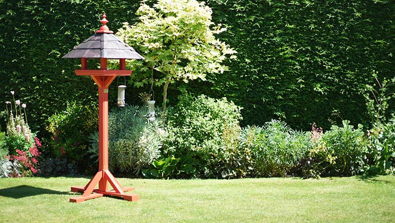 Beautiful bird table in a garden