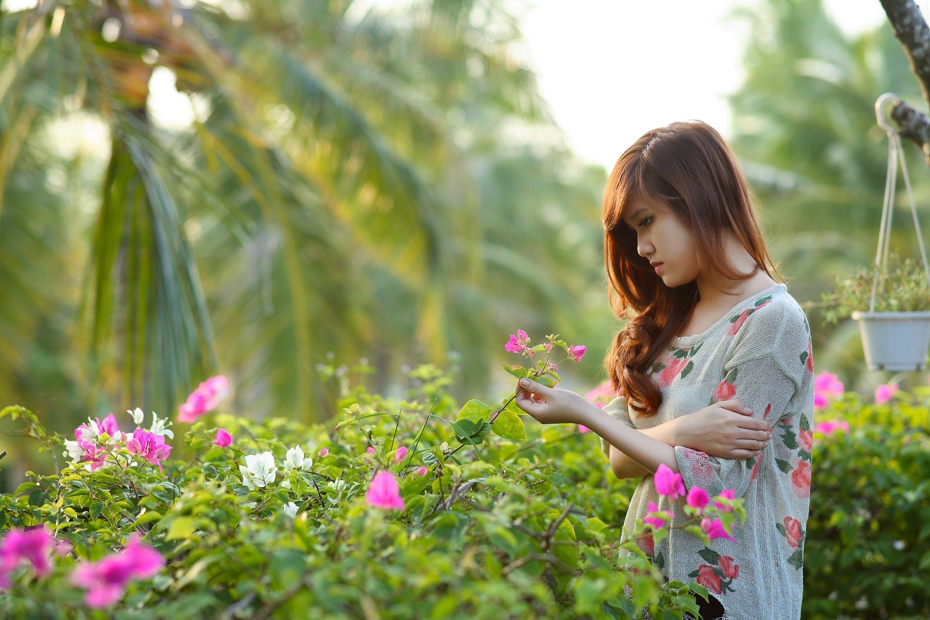 Woman enjoying the plants in her garden