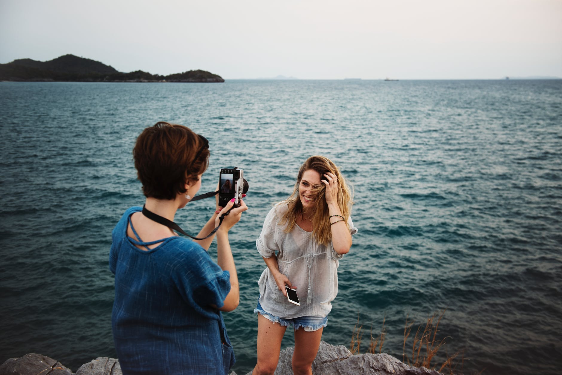 Woman with a waterproof camera taking pics