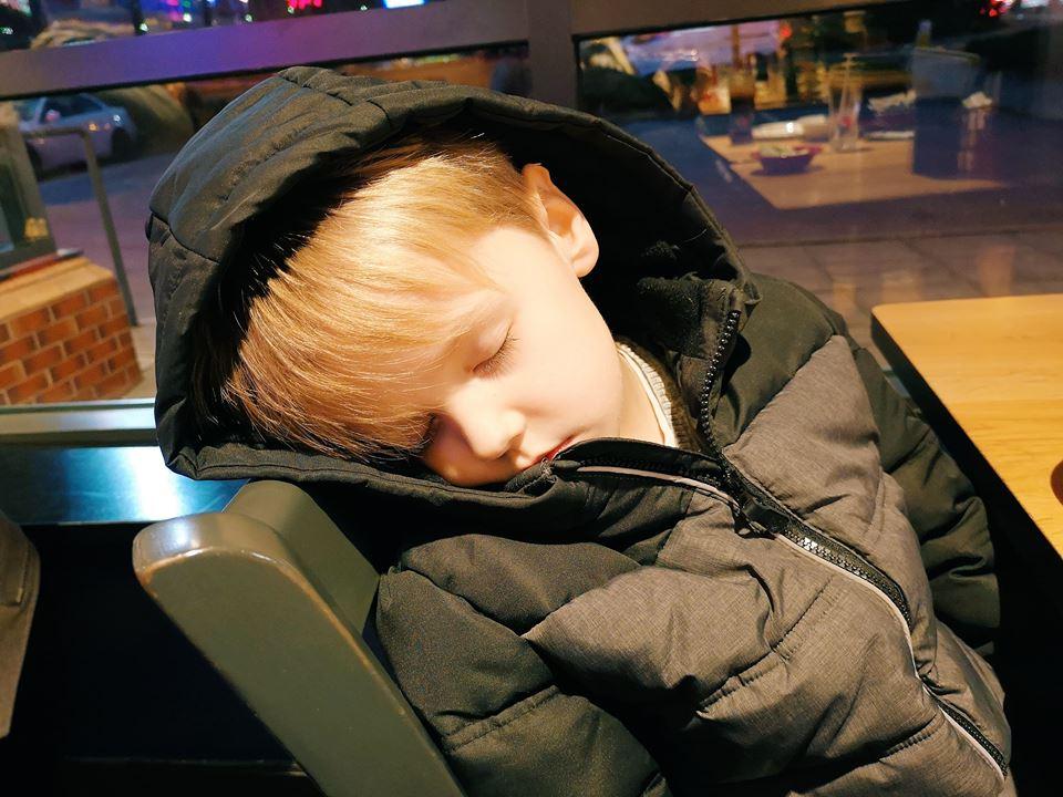 Poorly Oscar asleep at Pizza Hut