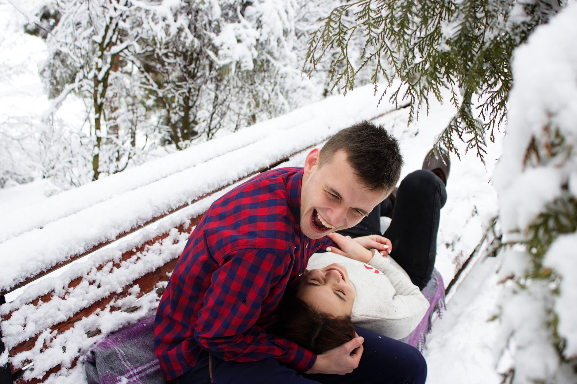 Couple having fun in a snowy garden